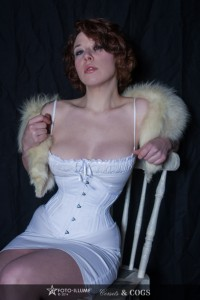 Model in a fur stole wearing a White Corset